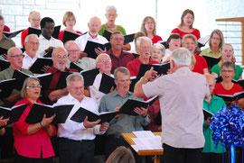 Tony Hogg conducting the Edgecumbe Choir in the 2103 'Christmas Joy' concert