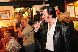 pub singing / courtesy of Photplibrary Wales