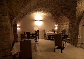 The vaulted dining room at Hotel Leone