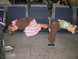 Jillian & Elijah sleeping in Frankfurt Airport