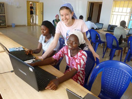 Hannah helping the students in the computer class