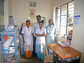 nurses and Father in charge of HIV / AIDS clinic