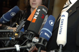 http://commons.wikimedia.org/wiki/Category:Broadcasting_microphones#mediaviewer/File:Flickr_-_europeanpeoplesparty_-_EPP_Summit_13_March_2008_(29).jpg