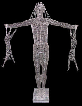 Girl with Cats. 2004. Wire mesh, chicken wire, river stones. 190 x 160 x 40cm. Owned by the artist. © Charles Rocco