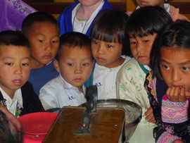 Serious look at children learning coffee