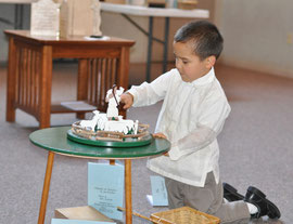 Young preschool child with hands-on Montessori Catechesis of the Good Shepherd materials