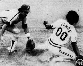 Larry Bowa applies the tag late as Barry Bonds slides.