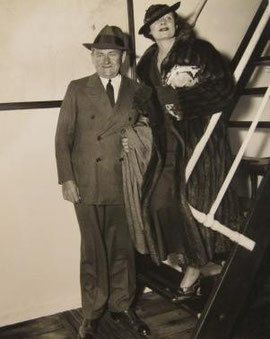 Irene Dunne and her husband, Dr.Francis Griffin, in New York. Their first trip together in four years. Irene says news pictures don't do Frank justice.