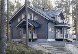 Blockhaus als Einfamilienhaus - Wohnblockhaus mit diffusionsoffener Lasur in Anthrazit - Außenanstrich