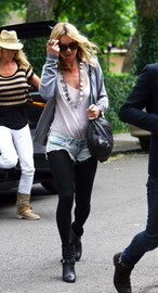 Kate Moss arriving home along with ex-atomic Kitten Jenny Frost. London UK