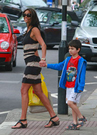 Melanie Sykes out with son in London UK