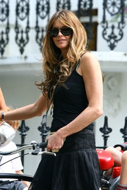 Elle Macpherson arriving for the school run. Notting Hill UK
