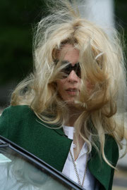 Claudia Schiffer with windswept hair. Notting Hill London UK