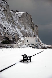 The empty bench: dark clouds frame the cliffs at the north end of St Margaret's Bay, 21st January, 2013