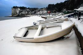 Boats, snow , bay