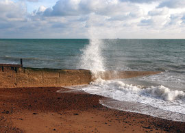 Spray and sandy beach - the shingle has been banked up elsewhere by the persistent easterlies