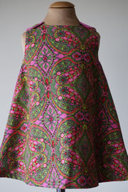 Voor: So cute jurkje met bloemenprint (groen) van fijn ribstof. Artikelcode 86-072. Prijs 32,95 excl. verzendkosten.