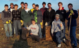 MHS Boy's Soccer Team after cleaning up Head Cemetery in rural Emmet Township. Front row, kneeling, left to right, Noah Blasi and Eli Blasi; middle row standing, left to right, Tyler Dively, Vasily Andreev, Ryan Fitzgerald, Matt Jansen, Jeff Mooney, Cal D