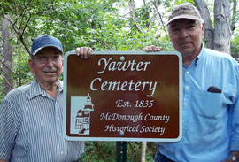 Alvin Curtis (left) attended the last funeral at the Vawter Cemetery in 1920. Son Dan Curtis installed the new sign and found over a dozen of the buried head and foot stones.