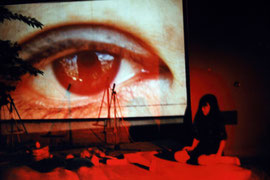 con-sequenze, Turin, 1994. Slideprojection on structures and Mayako Kubo performing.