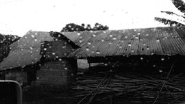 Mud house by the road in a village. Phonephotography by Chantal Edie
