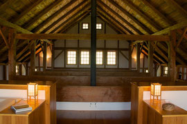 A view of the cathedral ceiling from our bedroom in the former hay-loft