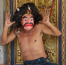 Bali, Batuan: Dewa Gede Mandra, master painter and mask-maker, displaying a caricature of a comic figure (tapel lucu)