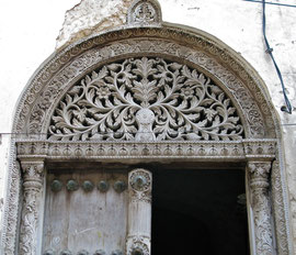 Tanzania, Zanzibar island: a richly decorated old wood door in Stone Town, indicative of the owner's wealth