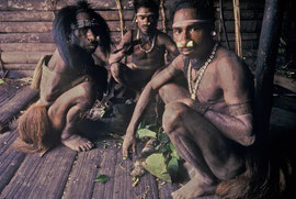 PNG, Nomad River: Biami men chewing betel nut on rear verandah of Waribi longhouse