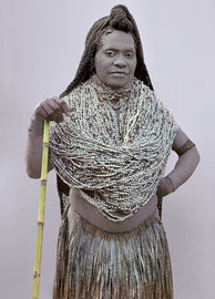 PNG, Southern Highlands, Mendi tribe: a widow in mourning dress named Molu Kon from Map village