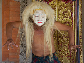 Bali, Batuan: Dewa Gede Mandra, master painter and mask-maker, displaying a caricature of an old man (tapel tua)