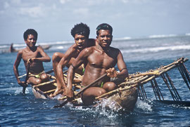PNG, Trobriand Islands: Kapwani men setting off to fish in outrigger canoes