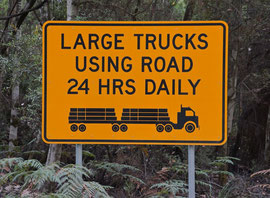 Tasmania, Derwent District: a road sign warning of logging trucks in Styx Forest