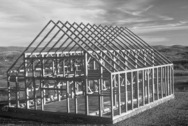 The completed barn frame with paired sets of rafters to support the roof