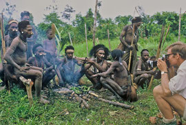 PNG, Nomad River: Malcolm Kirk uses a Polaroid camera to photograph a group of Biami tribesmen at Unawobi settlement