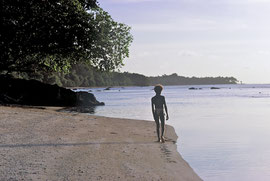 PNG, Trobriand Islands: Yamama, a future chief of Kapwani, strolling along the beach