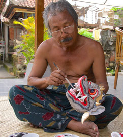 Bali, Batuan: Dewa Gede Mandra, master painter and mask-maker, painting a Tepel Jemawan mask