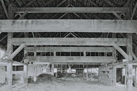The barn interior with its horizontal pine tie-beams (or anchor-beams) spanning the old threshing-floor