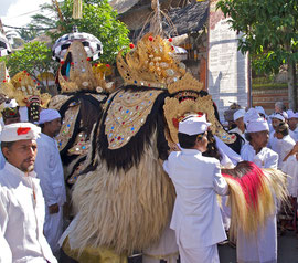 Bali, Ubud. Villagers bearing Barong masks for Odalan ceremony at Pura Dalem Kedewatan temple