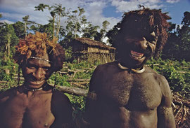 W. Papua, Asmat: we warned these two nervous inhabitants of Ti that they were about to be attacked by a raiding party from Monu