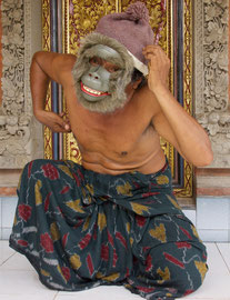 Bali, Batuan: Dewa Gede Mandra, master painter and mask-maker, displaying a caricature of a monkey (tapel bojog)