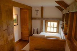The upstairs guest bedroom overlooks the valley below