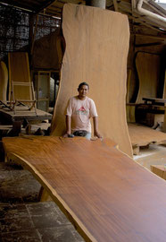 Bali, Mas: a large slab of timber, origin unknown, on display in a lumber yard