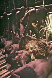 W. Papua, Asmat: the six 'children' from Wares undergo a re-birth, passing between the legs of their new mothers and over the backs of their new fathers