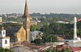 Tanzania, Zanzibar island: the Anglican church in Stone Town was built on the site of the former slave-market. Its altar rises on the very spot where the whipping-post once stood. To the right is one of the several mosques in town