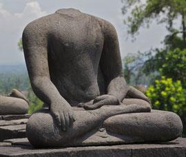 Java: headless statue at the 8th century Buddhist stupa & temple of Borobudur