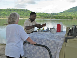 Tanzania, Selous game reserve: breakfast with our guide, Godwin, on the shore of Lake Tagalala