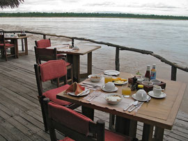 Tanzania, Selous game reserve:the outdoor dining terrace at Sand Rivers camp adjacent to the Rufiji river