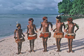 PNG, Trobriand Islands: Kapwani girls dancing on the beach
