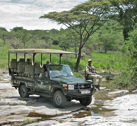 Tanzania, Klein's Camp: our ranger & driver, named Malley, and our Masai game spotter (seated on the hood) named Moisanga